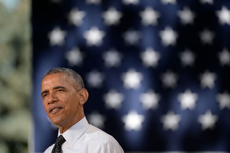 . President Obama speaking to a crowd of hand-picked guests at Cheesman Park July 9, 2014 in Denver. Obama next headed to raise money for U.S. Sen. Mark Udall\'s re-election campaign at a private luncheon at the Westin Denver Downtown hotel. (Photo by John Leyba/The Denver Post)