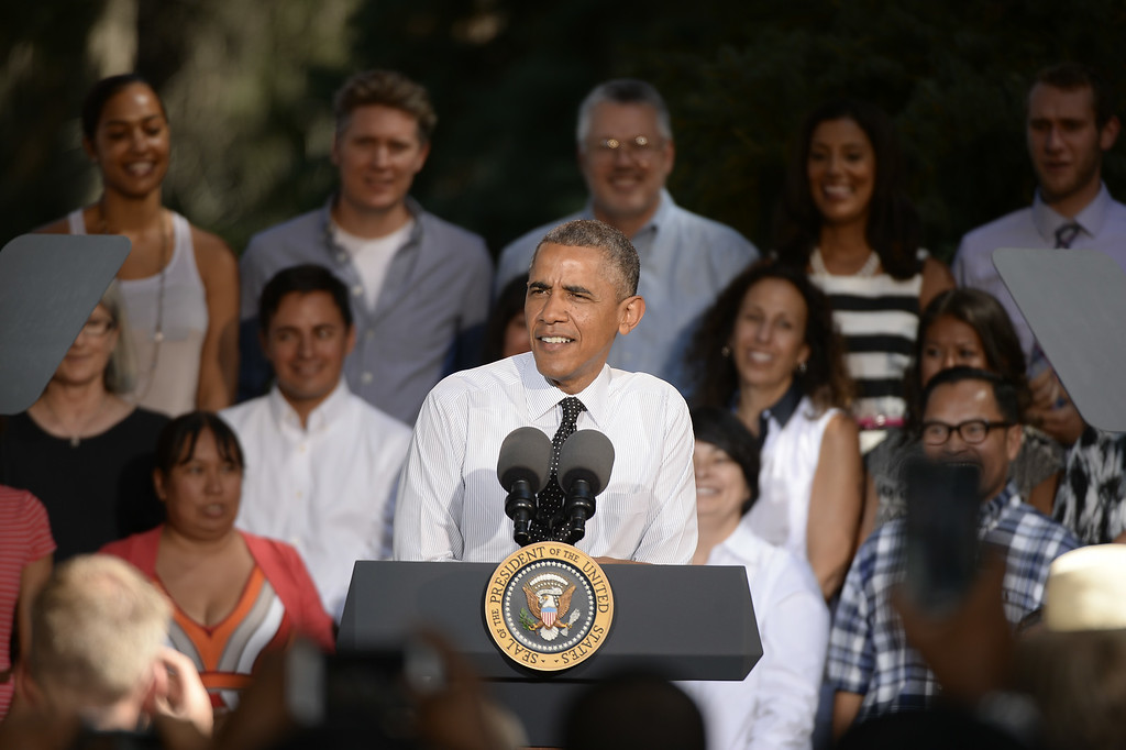 . President Obama discusses the economy at Cheesman Park July 9, 2014 and then will go to a private luncheon to raise money for U.S. Sen. Mark Udall\'s re-election at the Westin Denver Downtown hotel. President Obama spoke to a small audience of about 200 ticketed patrons. (Photo By John Leyba / The Denver Post)