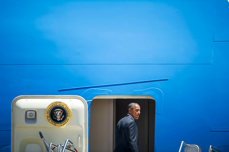 . U.S. President Barack Obama turns to wave as he boards Air Force One at Denver International Airport on Wednesday, July 09, 2014 in Denver, CO.  The President is en route to Dallas, TX where he will meet local elected officials and faith leaders to discuss the humanitarian situation at the Southwest border. (Photo by Kent Nishimura/The Denver Post)