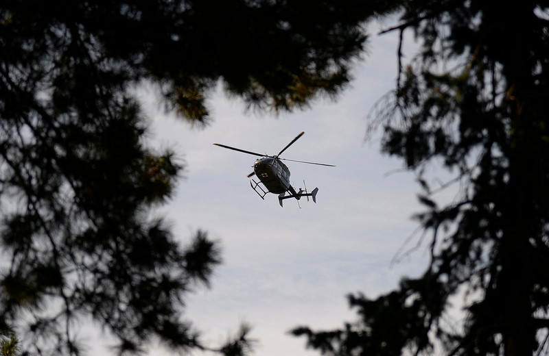 . Military helicopter circles high above Cheesman Park before the arrival of the President. President Obama spoke to a crowd of hand-picked guests at Cheesman Park July 9, 2014 in Denver. Obama next headed to raise money for U.S. Sen. Mark Udall\'s re-election campaign at a private luncheon at the Westin Denver Downtown hotel. (Photo by John Leyba/The Denver Post)