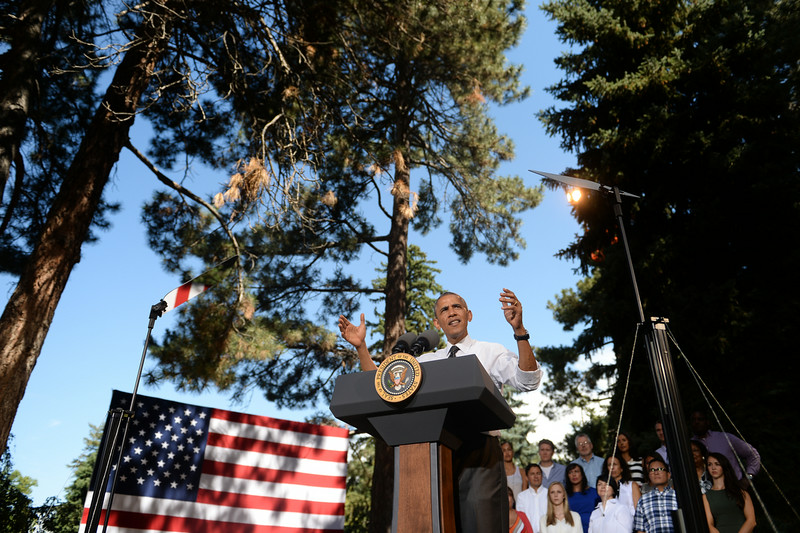. President Barack Obama discusses the economy during a speech at Cheesman Park in Denver, July 09, 2014. After the speech President Obama will attend a private luncheon at the Westin Denver Downtown hotel to raise money for U.S. Sen. Mark Udall\'s re-election campaign. (Photo by RJ Sangosti/The Denver Post)