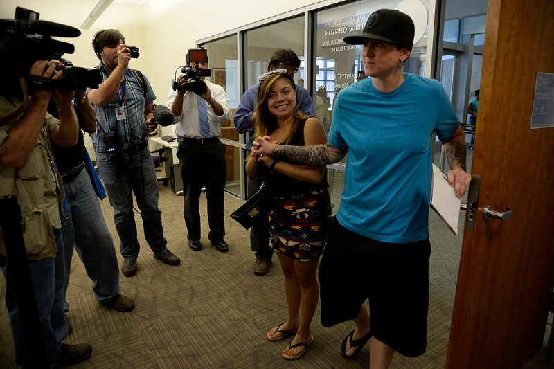 . Victoria Quintana (L) and Samantha Getman were the first couple to arrive the Denver County clerk\'s office where they began issuing same sex marriage licenses July 10, 2014. (Photo by John Leyba/The Denver Post)