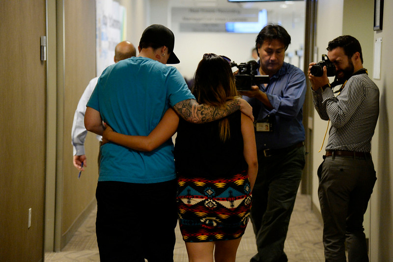 . Samantha Getman (L) and  Victoria Quintana walk arm in arm down the hall to get get their marriage license. They were the first couple to arrive the Denver County clerk\'s office where they began issuing same sex marriage licenses July 10, 2014. (Photo by John Leyba/The Denver Post)