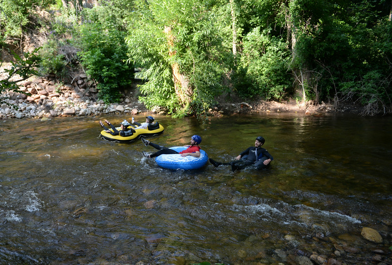 . Tubers make their way down Boulder Creek during Boulder\'s Tube to Work Day, July 15, 2014. Around 40 participants took their tubes down Boulder Creek on their way to work. (Photo by RJ Sangosti/The Denver Post)