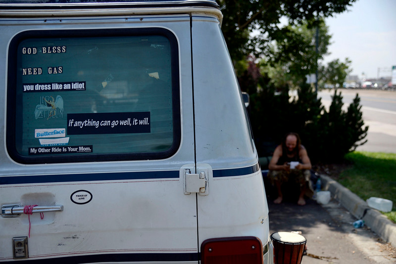 """. A sticker reading \""""If anything can go well, it will\"""" is on display in the back window of Jeffrey \""""Gator\"""" Harris\' Chevy van, which rings true of his nature in trying to find the positive in any situation. (Photo by AAron Ontiveroz/The Denver Post)"""
