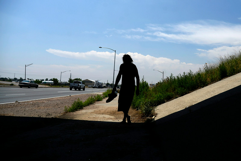 """. Jeffrey \""""Gator\"""" Harris walks along Vasquez in search of a rim for his damaged Chevy Van.(Photo by AAron Ontiveroz/The Denver Post)"""
