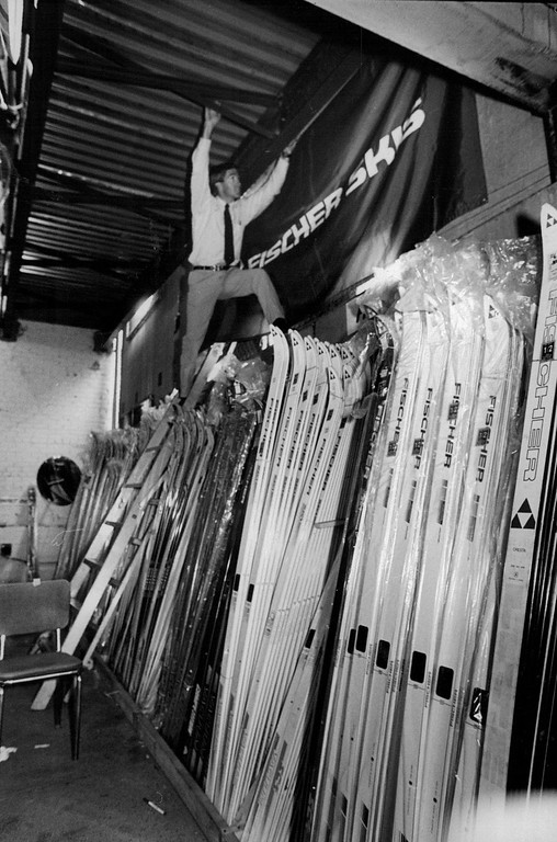. Kerry Lynch former Olympic cross country skier in 1980 and 84 is up on the ladder setting up the Fischer Ski display at Gart Bros Castle for the annual Snigrab ski sale 1n 1988. Lynch works for Fischer.  Credit: The Denver Post