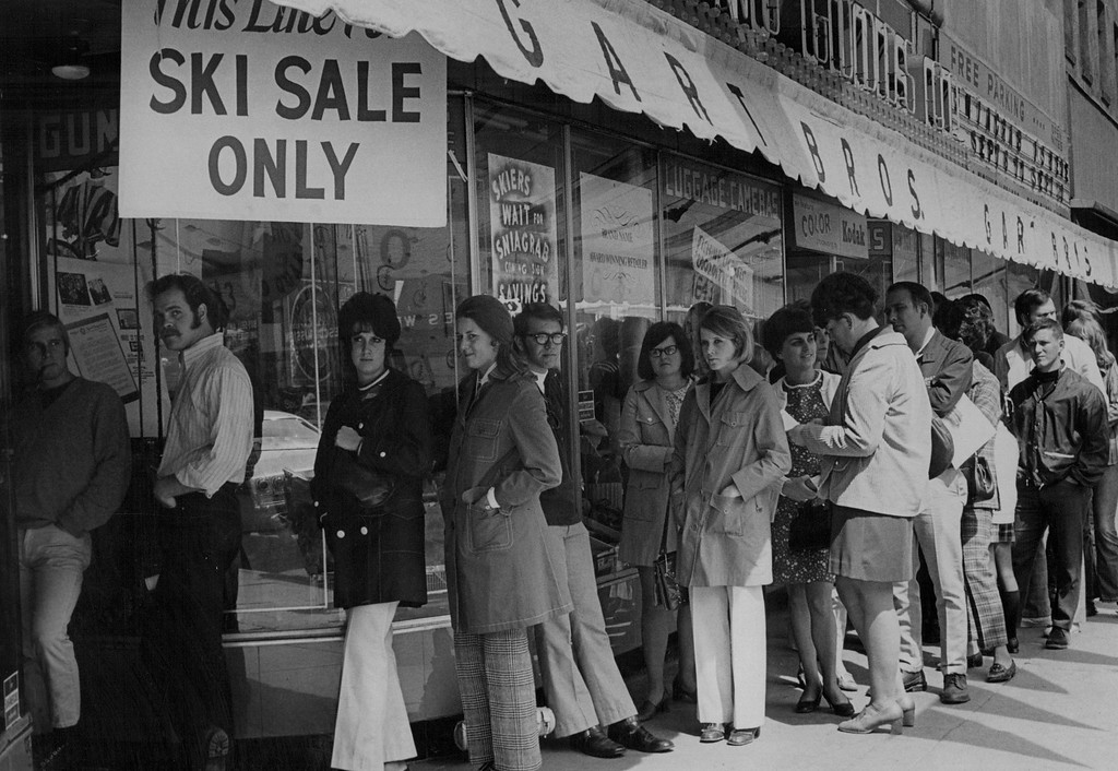 . SEP 12 1970, SEP 16 1970  Something to Wait For at Gart\'s  Prospective skiers use the sidewalk for waiting room at Gart Bros, main store, where the annual Sniagrab sale is continuing through this week. Gart officials said the sale - Bargains spelled backwards - is breaking store records. They said preparations for the sale begin seven months ahead of time at ski trade shows. Factory overstocks and carryover merchandise bought from ski shops by Gart Bros, at the end of the previous season help lure the customers.  Credit: Denver Post