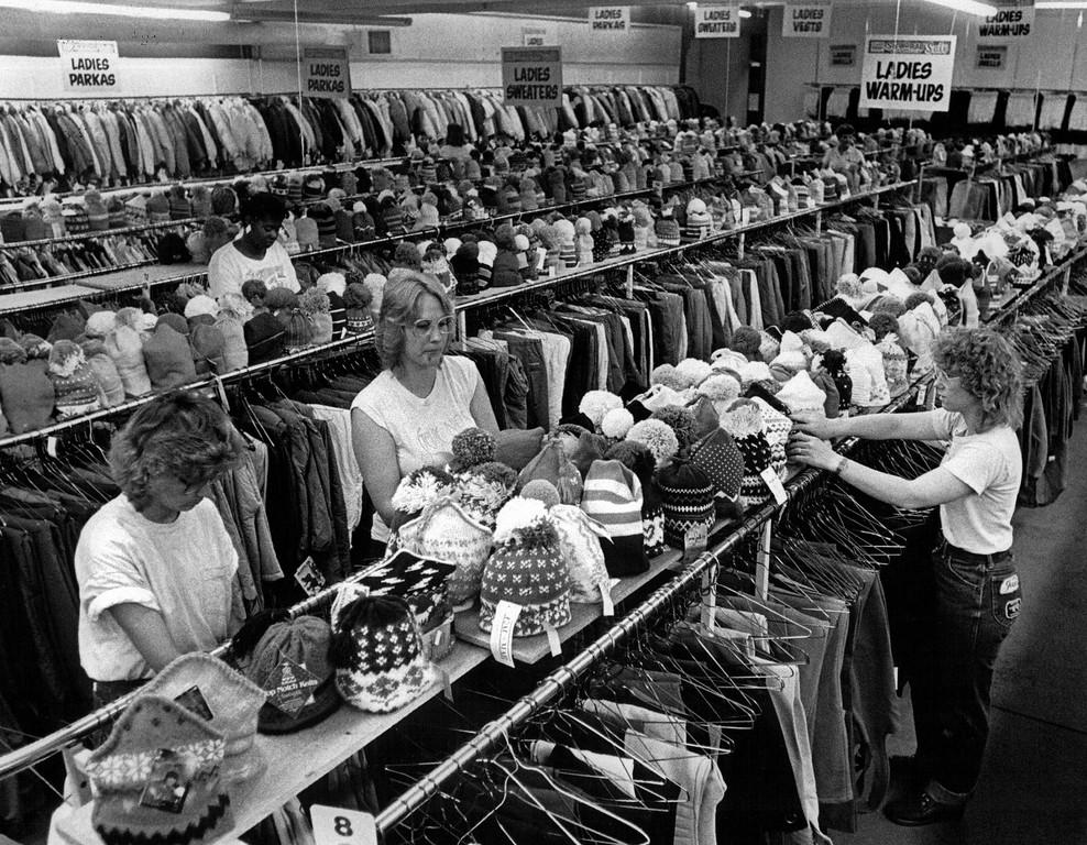 . Gart Bros. 10th And Broadway 1987 Preparations For 33rd Annual Snigrab Ski Sale, Ladies Placing Ski Clothing on Hangars.  Credit: The Denver Post