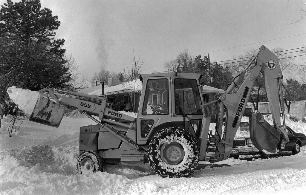 . A backhoe cleaning up after the Blizzard of \'82. Denver Post Library Archive