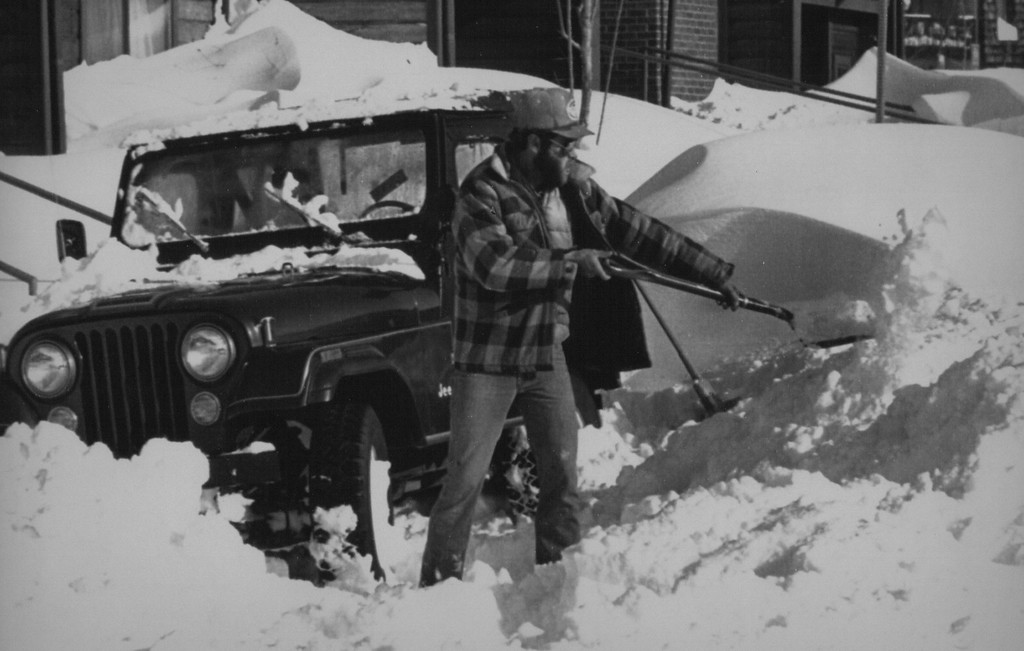 . Jeff Hakmen shovels snow from around his stranded four-wheel drive vehicle at his home in Denver on Christmas day 1982. More than two-feet of snow fell on the Denver area on Christmas Eve stranding thousands enroute to visit relative for Christmas. 1982. Credit: AP Laserphoto