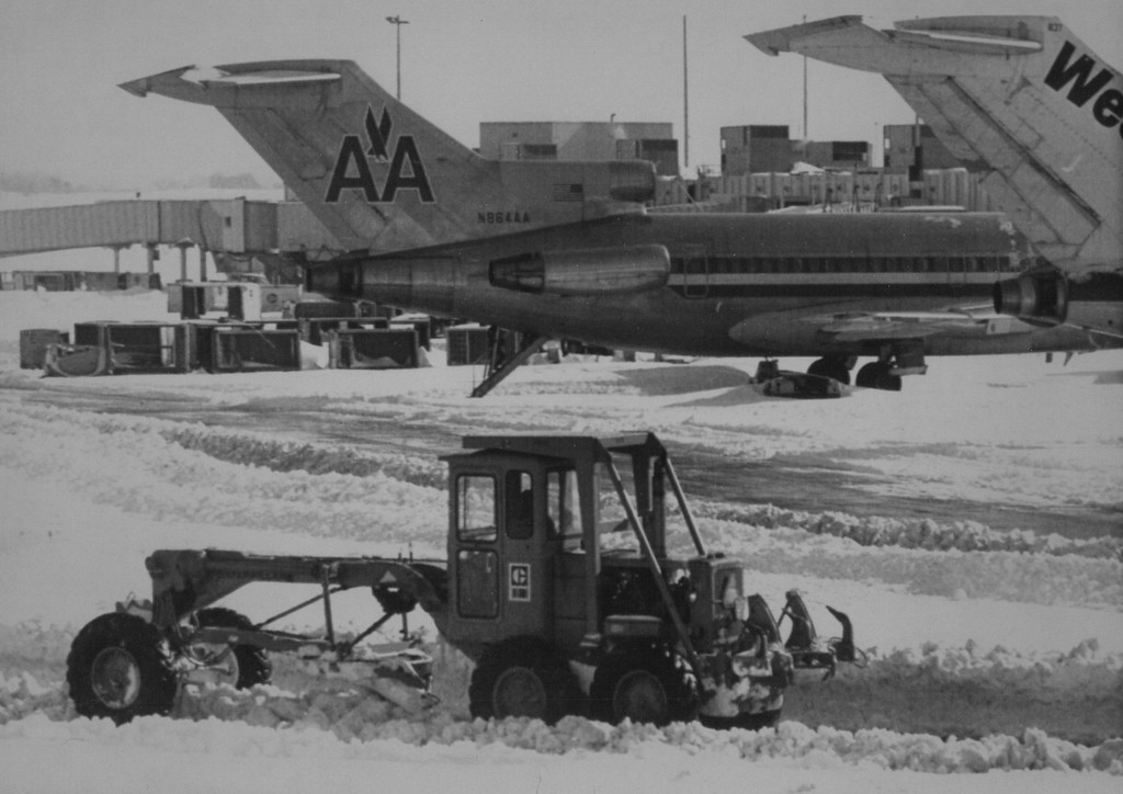 . A road grader clears snow from ramps around the concourses at Stapleton International Airport, where air traffic was halted Christmas Eve and much of Christmas Day because of a blizzard that paralyzed the city. Most airlines chose to cancel all Christmas flight despite efforts to open a runway by dusk. 1982. Credit: AP Laserphoto. Denver Post Library Archive