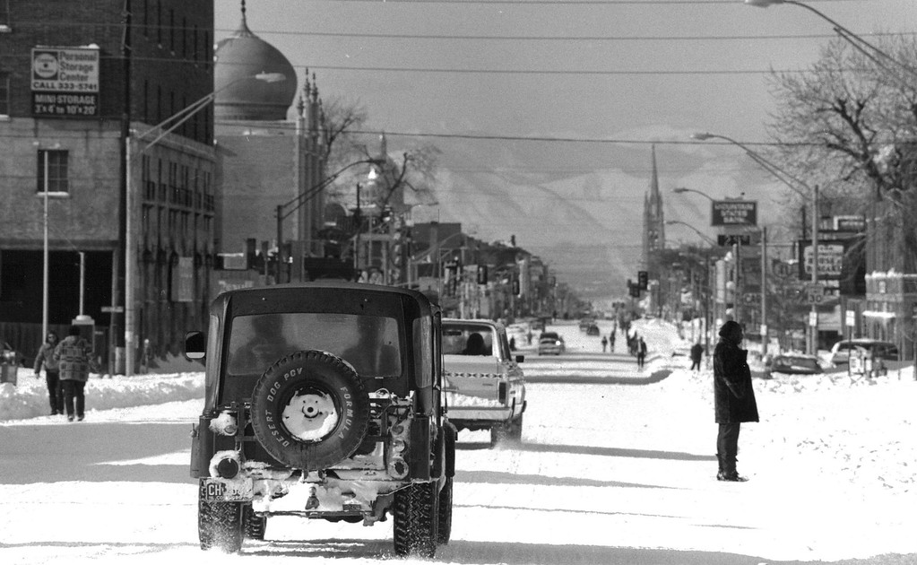 . Appearing much like a resort town, Denver as seen from Colfax avenue looking west showed Christmas morning, a select number of autos, mainly four wheeled drive vehicles and lots of residents coming to the streets to look at the blizzard remains. Denver Post Library Archive