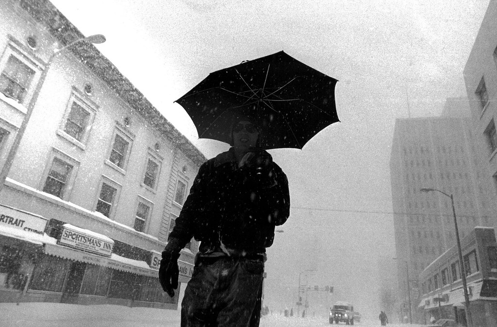 . A pedestrian walks down 15th street at California during the blizzard of \'82. Anthony Suau,  The Denver Post
