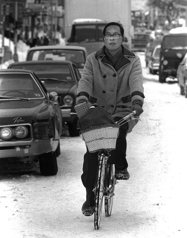 . A man rides his bike down the street after the Blizzard of \'82. Denver Post Library Archive