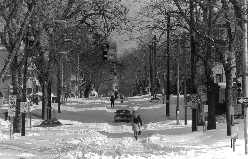 . People make their way down the snow covered streets after the Blizzard of \'82. Denver Post Library Archive