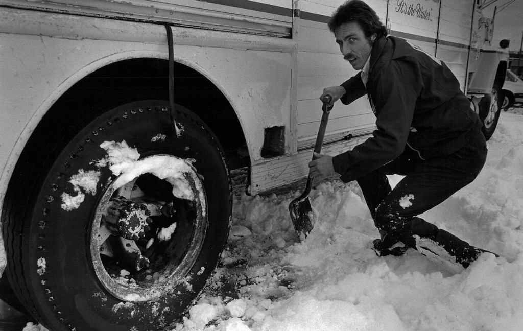 . A man doesn\'t look very happy about having to dig out his truck in the Blizzard of \'82. Denver Post Library Archive