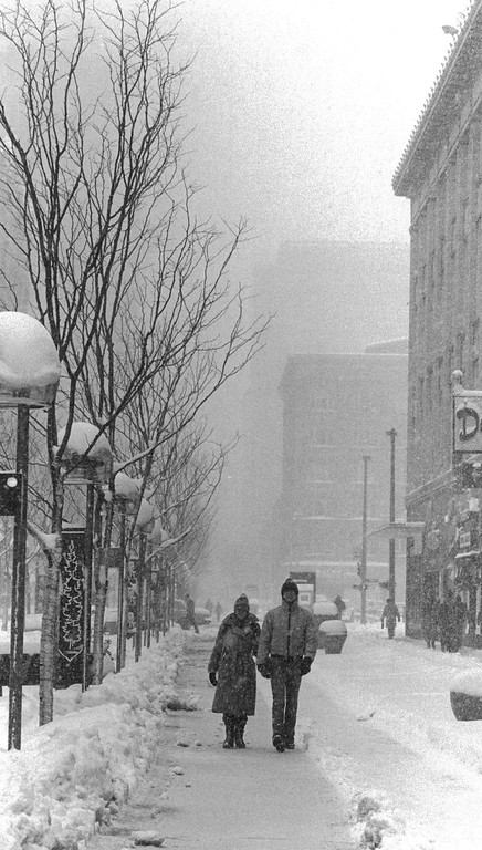 . People out for a walk in the Blizzard of \'82. Lyn Alweis,  The Denver Post