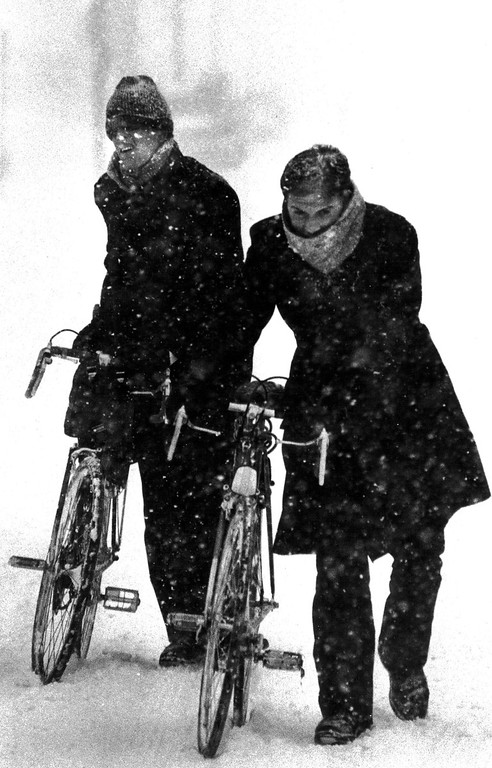 . Two men had to push their bikes down the snow covered streets during the Blizzard of \'82. Denver Post Library Archive
