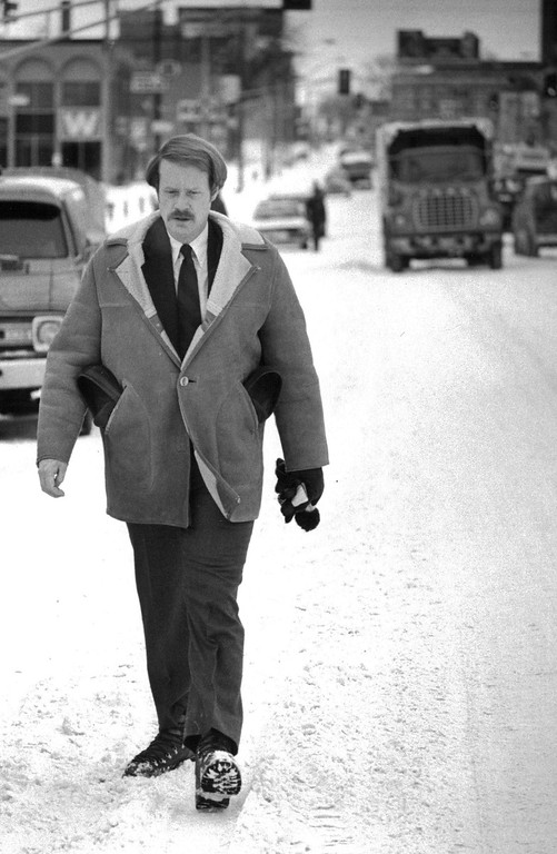 . Charles Bonniwell, walks westbound on Colfax Monday morning after the blizzard of \'82 on his way to work from his home on Williams street east of Boradway. Bonniwell carried his dress shoes in his coat pockets. Eric Bakke,  The Denver Post