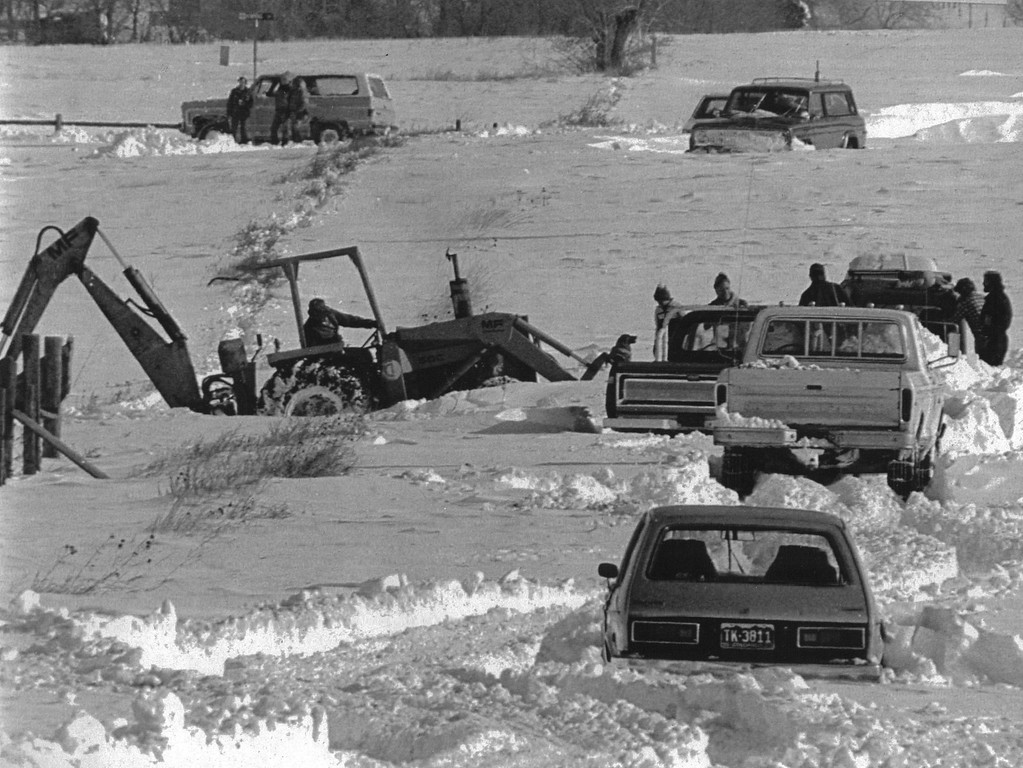 . A tractor tries to help free five cars in Broomfield which are buried in the snow December 25, 1982. A blizzard dumped up to three feet of snow on Denver. Credit: UPI. Denver Post Library Archive
