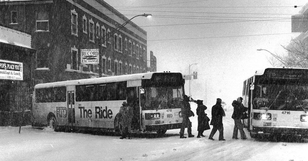 . People switch busses after one slid off the street during the Blizzard of \'82. Denver Post Library Archive
