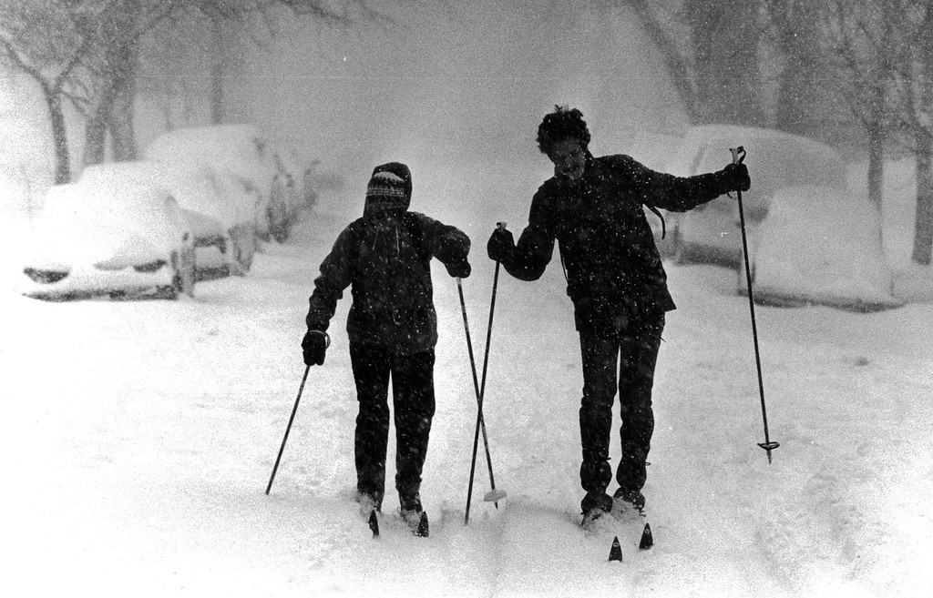 . People cross country skiing down the street during the Blizzard of \'82. Denver Post Library Archive