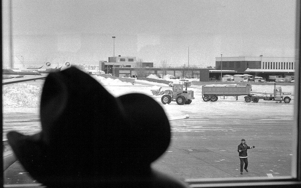 . The view from one Stapelton bar on the D concourse showed snow removal coming along just fine Monday after the Blizzard of \'82. Officials there claim to have service back to normal by Wednesday. Eric Bakke,  The Denver Post