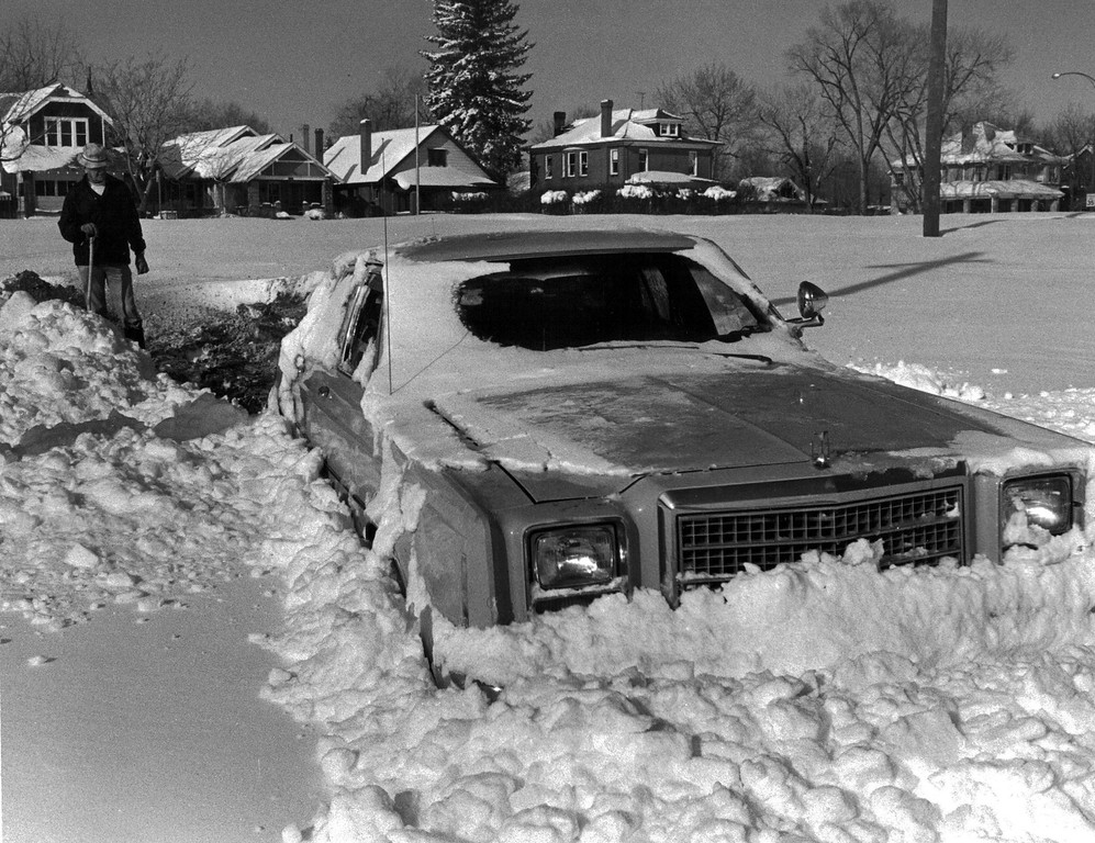 . A man trying to dig out his car after the Blizzard of \'82. Denver Post Library Archive