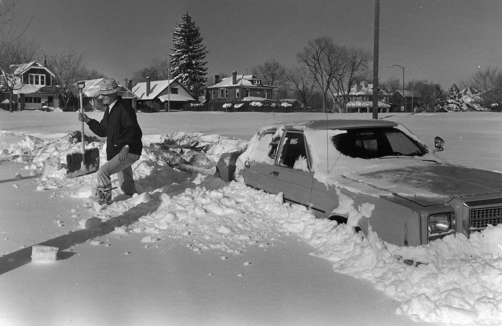 . Herb Schneider trying to dig out his car. He would dig a little and then with chains on he would drive forward. Getting out was slow but he was making it until his chains broke. He decided they would just have to come and tow it out. Dave Buresh, The Denver Post  blizzards Denver Christmas blizzard of 1982  Credit: The Denver Post