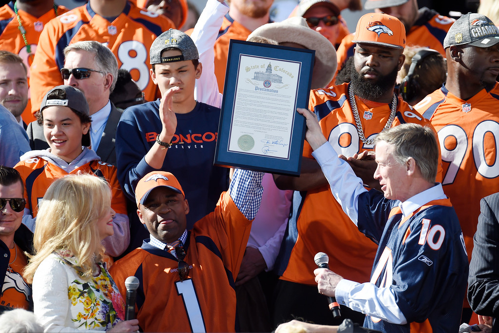 . Denver Mayor Michael B. Hancock (bottom center) and governor John Hickenlooper (bottom right) hold a joint proclamation making the day Pat Bowlen day as his wife, Annabel Bowlen, looks on during the Denver Broncos Super Bowl championship celebration and parade on Tuesday February 9, 2016. (Photo By AAron Ontiveroz/The Denver Post)