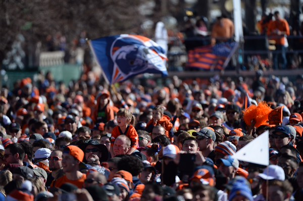 . DENVER, CO - FEBRUARY 9: A young girl sits on a man\'s shoulders for a better a rage point as a large crowd gathers in Civic Center Park for a Denver Broncos Super Bowl championship celebration on Tuesday, February 9, 2015. (AAron Ontiveroz/The Denver Post)