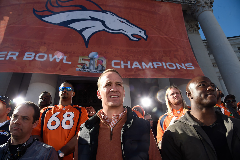 . Denver Broncos Peyton Manning stands with DeMrcus Ware on stage as they look out over the crowd during the teams celebration. The Denver Broncos celebrated their Super Bowl victory with a  a parade and celebration February 9, 2016 at the City & County Building. (Photo By John Leyba/The Denver Post)