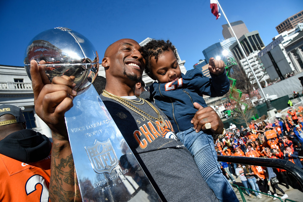 . Denver Broncos Aqib Talib holds up the Super Bowl trophy with his child in hand,  to the crowd on stage during the celebration. The Denver Broncos celebrated their Super Bowl victory with a  a parade and celebration February 9, 2016 at the City & County Building. (Photo By John Leyba/The Denver Post)