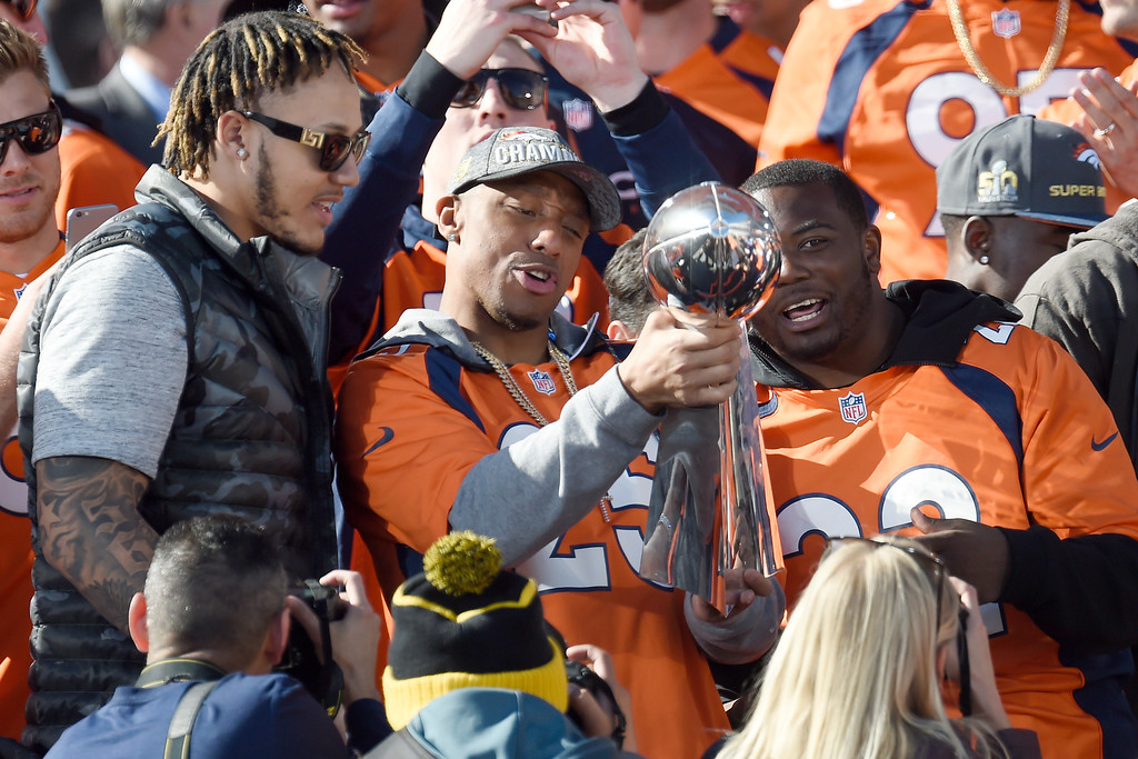 . From left, Shane Ray, Chris Harris Jr., and CJ Anderson celebrate with the Lombardi Trophy during the Denver Broncos Super Bowl championship celebration and parade on Tuesday February 9, 2016. (Photo By AAron Ontiveroz/The Denver Post)
