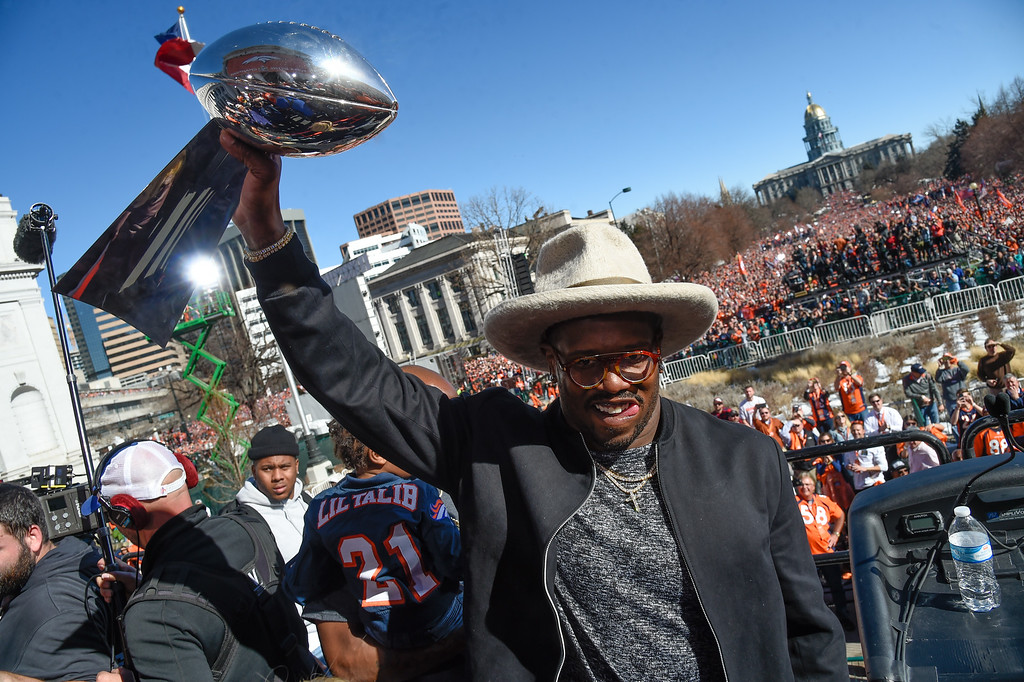 . Denver Broncos Von Miller smiles as he holds up the Super Bowl trophy on the stage during the celebration. Von Miller was named MVP of Super Bowl 50 after their 24-10 victory over the Carolina Panthers. The Denver Broncos celebrated their Super Bowl victory with a  a parade and celebration February 9, 2016 at the City & County Building. (Photo By John Leyba/The Denver Post)