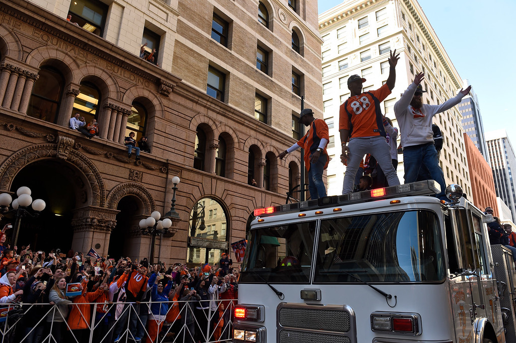 . DENVER, CO - JANUARY 9:  Wide receivers Demaryius Thomas, #88, Emmanuel Sanders, #10, left, and Patrick Bowlen III, Broncos owner Pat Bowlen\'s son, stand atop a Denver Fire Department engine as they ride up 17th Street  during the Denver Broncos Super Bowl 50 victory parade on February 9, 2016 in Denver, Colorado.   (Photo by Helen H. Richardson/The Denver Post)