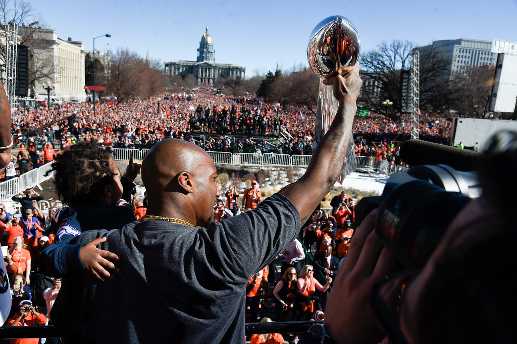 . Denver Broncos Aqib Talib holds up the Super Bowl trophy to the crowd on stage during the celebration.  The Denver Broncos celebrated their Super Bowl victory with a  a parade and celebration February 9, 2016 at the City & County Building. (Photo By John Leyba/The Denver Post)