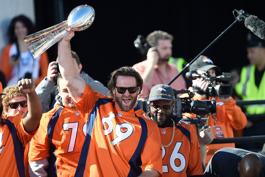 . Evan Mathis hoists the Lombardi Trophy during the Denver Broncos Super Bowl championship celebration and parade on Tuesday February 9, 2016. (Photo By AAron Ontiveroz/The Denver Post)