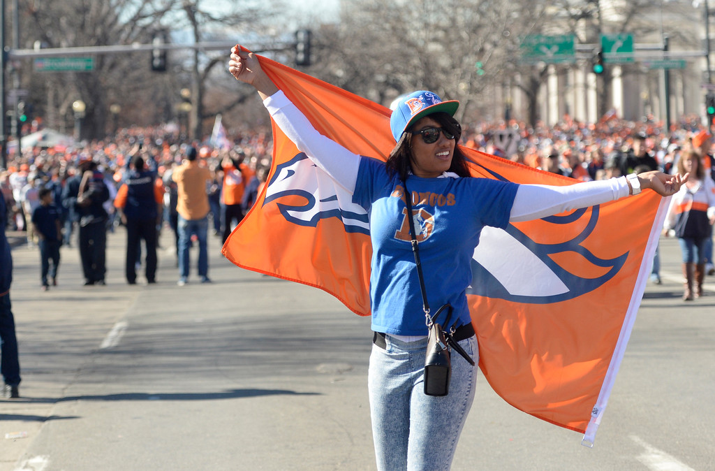 . The Denver Broncos were celebrating their Super Bowl victory with a parade through the streets of Denver on Tuesday, February 09, 2016. Bre Epps walks on Colfax Ave after the rally concluded.   (Photo by Cyrus McCrimmon/ The Denver Post)