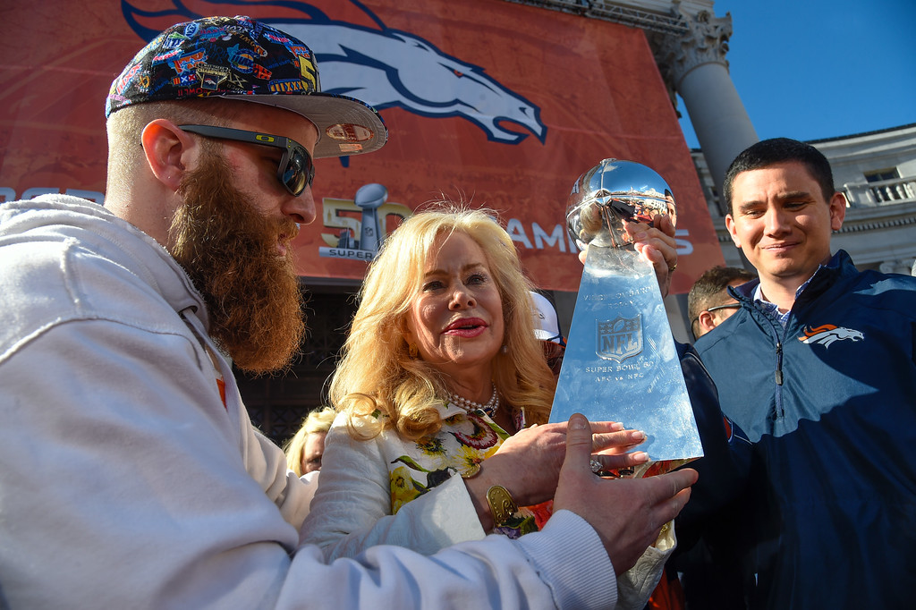 . Patrick Bowlen hands over the Super Bowl trophy to his mom Annabel Bowlen during the celebration. The Denver Broncos celebrated their Super Bowl victory with a  a parade and celebration February 9, 2016 at the City & County Building. (Photo By John Leyba/The Denver Post)