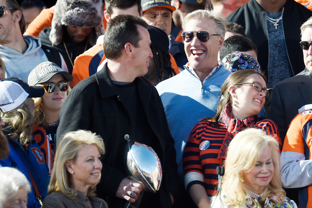 . Vice president of football operations John Elway (left) and head coach Gary Kubiak joke during the Denver Broncos Super Bowl championship celebration and parade on Tuesday February 9, 2016. (Photo By AAron Ontiveroz/The Denver Post)