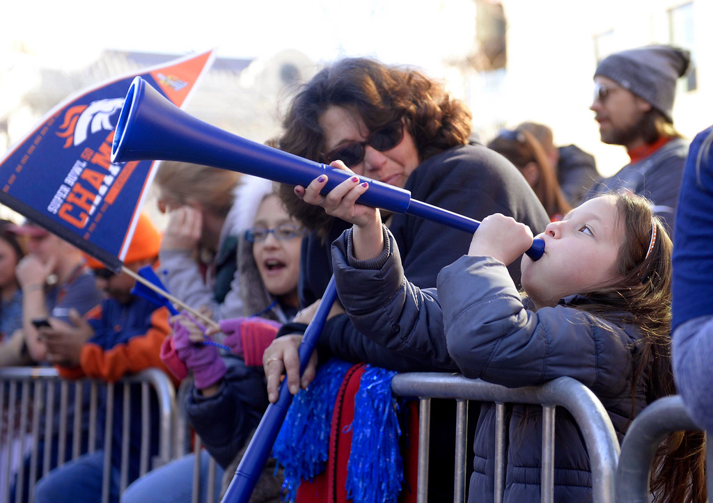 . DENVER, CO - FEBRUARY 9: 7 year old Marley Arviso blows a horn before the Broncos Super Bowl 50 Championship parade at Civic Center Tuesday morning, February 9, 2016. (Cyrus McCrimmon/The Denver Post)