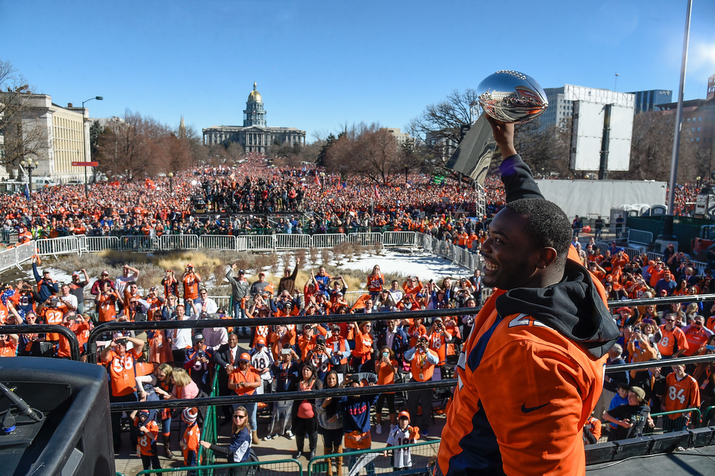 . Denver Broncos C.J. Anderson holds up the Super Bowl trophy to the crowd on the stage during the celebration. The Denver Broncos celebrated their Super Bowl victory with a  a parade and celebration February 9, 2016 at the City & County Building. (Photo By John Leyba/The Denver Post)
