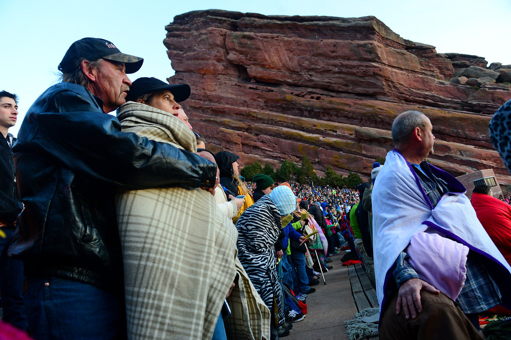 """. Rick Stone, left,  hugs Connie Spinelli as the two enjoy  the 67th annual Easter sunrise service  at Red Rocks Amphitheater in Morrison, Colorado, on April 17, 2014.  Superintendent Patrick L. Demmer gave the sermon which was entitled \""""What are you looking for?\"""".  The popular annual event, which hosts thousands of worshipers, is sponsored by the Colorado Council of Churches.  (Photo By Helen H. Richardson/ The Denver Post)"""