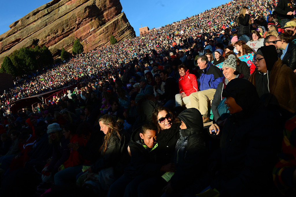 """. Estela Williams middle, hugs her kids Julian, 12, left and Ellis, 9, right  as they  enjoy the rising sun and the sermon during the 67th annual Easter sunrise service  at Red Rocks Amphitheater in Morrison, Colorado, on April 17, 2014.  Superintendent Patrick L. Demmer gave the sermon which was entitled \""""What are you looking for?\"""".  The popular annual event, which hosts thousands of worshipers, is sponsored by the Colorado Council of Churches.  (Photo By Helen H. Richardson/ The Denver Post)"""
