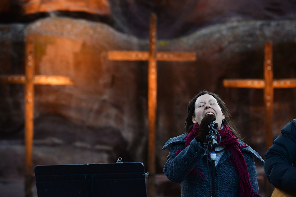 """. Vocalist Rebecca Gale, accompanied by acoustic guitarist Jeff Wahl, performs during  the 67th annual Easter sunrise service  at Red Rocks Amphitheater in Morrison, Colorado, on April 17, 2014.  Superintendent Patrick L. Demmer gave the sermon which was entitled \""""What are you looking for?\"""".  The popular annual event, which hosts thousands of worshipers, is sponsored by the Colorado Council of Churches.  (Photo By Helen H. Richardson/ The Denver Post)"""