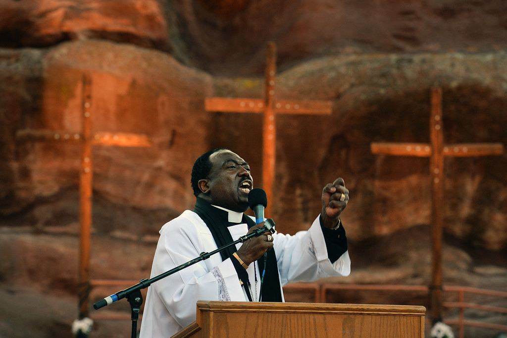 """. Superintendent Patrick L. Demmer raises his fist during an exuberant and passionate sermon entitled  \""""What are you looking for?\"""". during the 67th annual Easter sunrise service  at Red Rocks Amphitheater in Morrison, Colorado, on April 17, 2014. The popular annual event, which hosts thousands of worshipers, is sponsored by the Colorado Council of Churches.  (Photo By Helen H. Richardson/ The Denver Post)"""