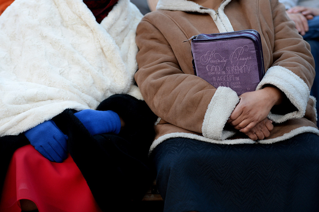 """. Sondra Taylor, right, holds her bible as she stays warm next to her mother Neda Gordon, left, as the two enjoy  the 67th annual Easter sunrise service  at Red Rocks Amphitheater in Morrison, Colorado, on April 17, 2014.  Superintendent Patrick L. Demmer gave the sermon which was entitled \""""What are you looking for?\"""".  The popular annual event, which hosts thousands of worshipers, is sponsored by the Colorado Council of Churches.  (Photo By Helen H. Richardson/ The Denver Post)"""