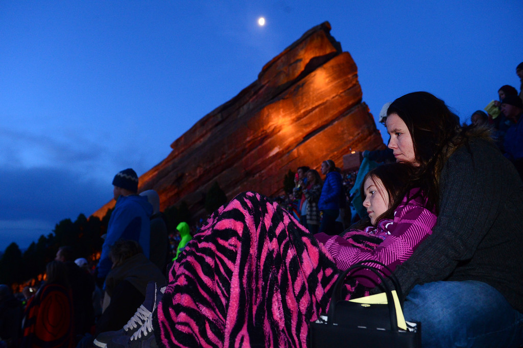 """. Kitty Olson and her daughter Kalie, 10, snuggle under warm blankets as the 67th annual Easter sunrise service  at Red Rocks Amphitheater in Morrison, Colorado, on April 17, 2014 gets under way.    Demmer\'s sermon was entitled \""""What are you looking for?\"""".  The popular annual event, which hosts thousands of worshipers, is sponsored by the Colorado Council of Churches.  (Photo By Helen H. Richardson/ The Denver Post)"""
